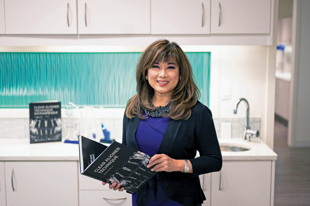 Sandra Tai with book clear aligner techniques