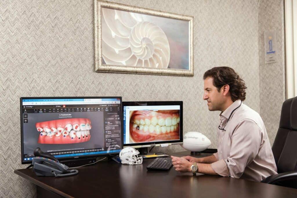 Dr Jonathan Nicozisis at computer